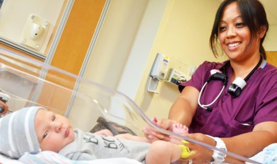 nurse and baby happy